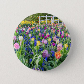 Flowers field with tulips hyacinths and bridge pinback button