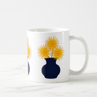 Flowers in a blue vase mugs