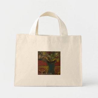 flowers in blue vase mini tote bag
