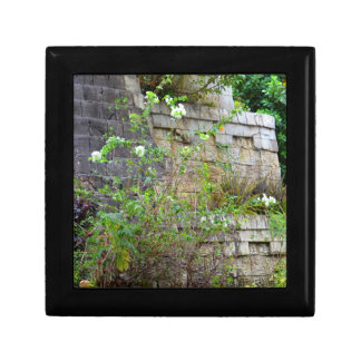 flowers in front of old stone wall gift box