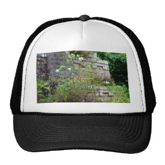 flowers in front of old stone wall trucker hat