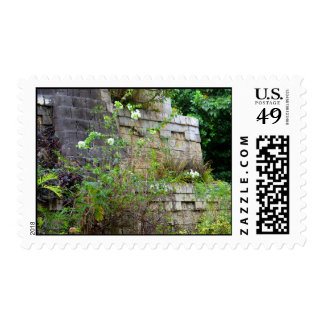 flowers in front of old stone wall postage