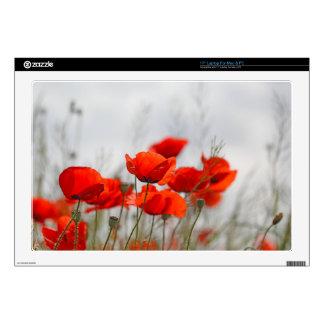 """Flowers of common poppy in a field. 17"""" laptop skin"""