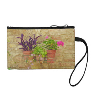 Flowers on brick wall. coin wallet