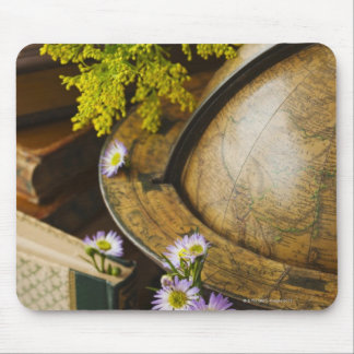 Flowers with antique globe and books mouse pad
