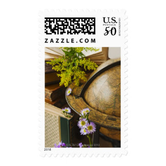 Flowers with antique globe and books postage