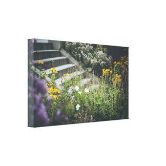 Flowery garden with a ladder canvas print