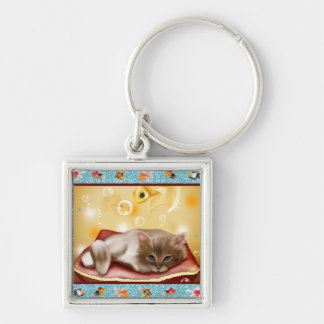 Fluffy baby Kitten on pillow day dreaming of fish Keychain