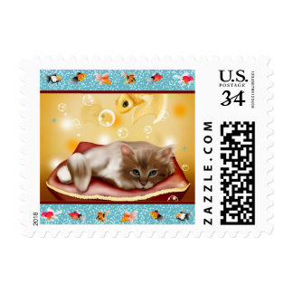 Fluffy baby Kitten on pillow day dreaming of fish Postage