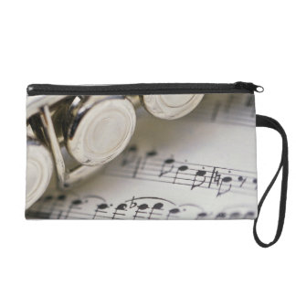 Flute on Sheet Music Wristlet Clutches