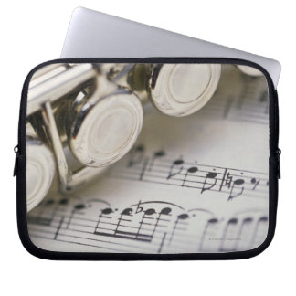 Flute on Sheet Music Laptop Sleeve