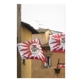 Fluttering flags in Volterra village . Tuscany Stationery