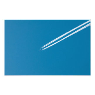 Flying airplane on a blue sky background flyer