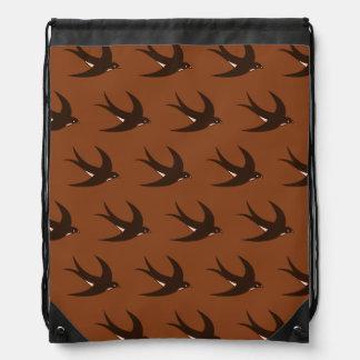 Flying Bird Pattern brown Drawstring Backpacks