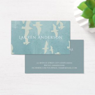 Flying birds, seagulls in flight on teal blue business card
