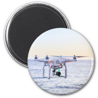Flying drone at coast above sea magnet