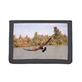 flying duck over water photograph trifold wallet