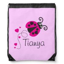Flying heart ladybug kids name pink drawstring bag