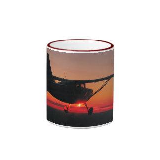 Flying into the sunset mug