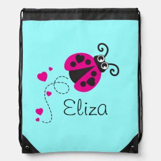 Flying ladybug kids name aqua pink drawstring bag