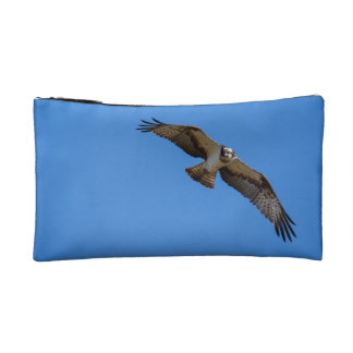Flying osprey with a target in sight makeup bag