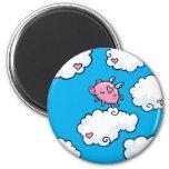 Flying pig dances on clouds fridge magnet