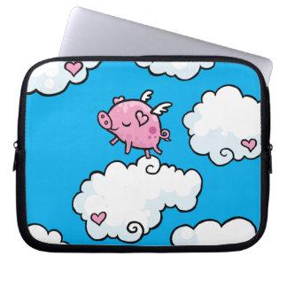 Flying pig dances on clouds laptop sleeve