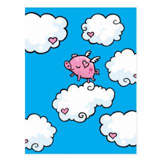 Flying pig dances on clouds postcard