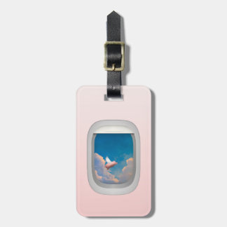 flying pig through airplane window luggage tags
