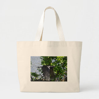 Flying Raven in Sunlight Wildlife Photo Large Tote Bag