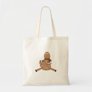 flying reindeer gingerbread man tote bags