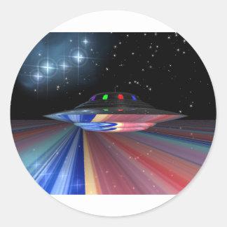 Flying saucer above Saturn Round Sticker