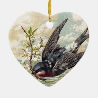 Flying swallow with flower twig adorno navideño de cerámica en forma de corazón