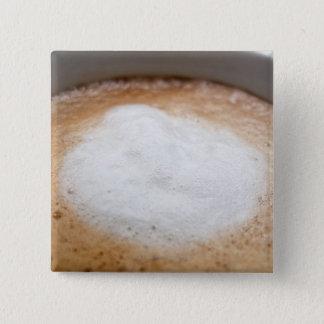 Foam on cappuccino, close-up button