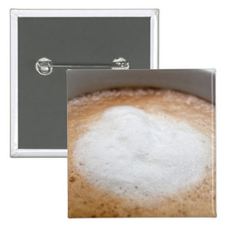 Foam on cappuccino, close-up button