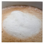 Foam on cappuccino, close-up large square tile