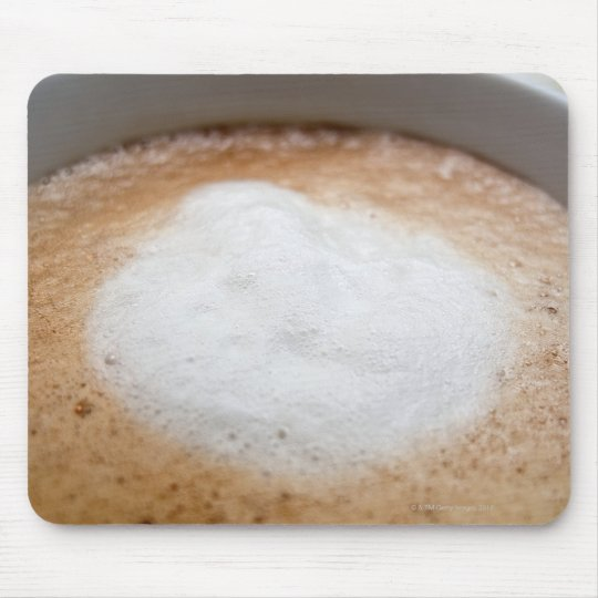 Foam on cappuccino, close-up mouse pad