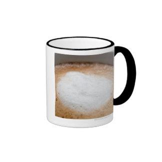 Foam on cappuccino, close-up ringer mug