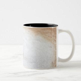 Foam on cappuccino, close-up Two-Tone coffee mug