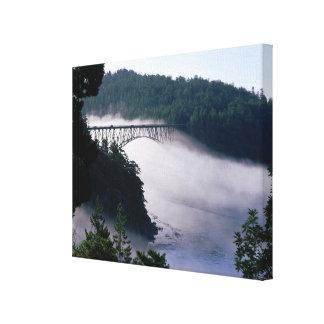 Fog drifts under the Deception Pass bridge at Canvas Print