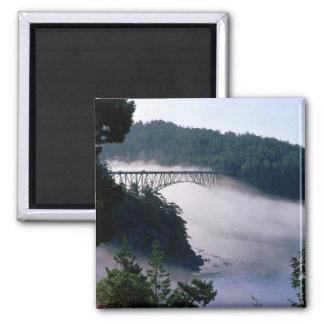 Fog drifts under the Deception Pass bridge at Fridge Magnet