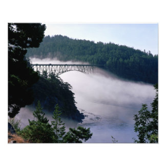 Fog drifts under the Deception Pass bridge at Photographic Print