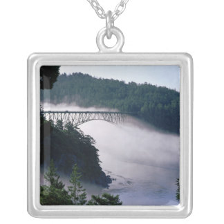 Fog drifts under the Deception Pass bridge at Silver Plated Necklace