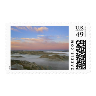 Fog from the Little Missouri River hangs in the Postage Stamp