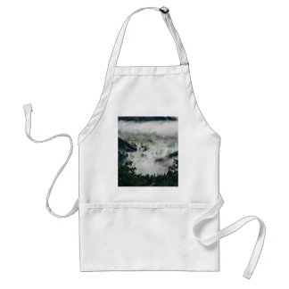 Fog hangs in thick clouds over forest adult apron