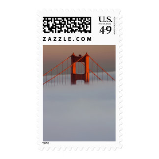 Fog rolls through the San Francisco bay covering 2 Stamp