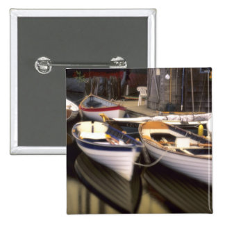 Fog surrounds four boats docked. 2 inch square button