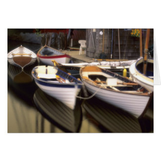 Fog surrounds four boats docked. greeting card