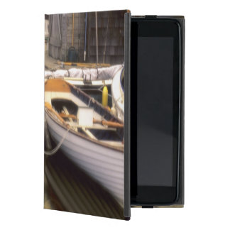 Fog surrounds four boats docked. cases for iPad mini