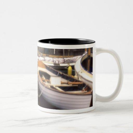 Fog surrounds four boats docked. Two-Tone coffee mug
